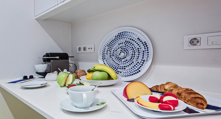 Fruit, croissants and other delicious dishes served in the kitchen