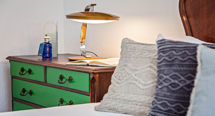 Wonderful green brown chest of drawers with a night lamp