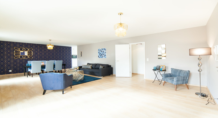 Palatial living room space with blue furniture