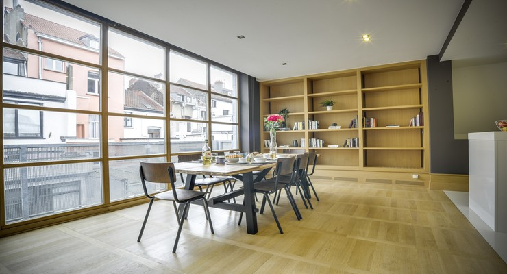 Spacious dining area with rich dining table