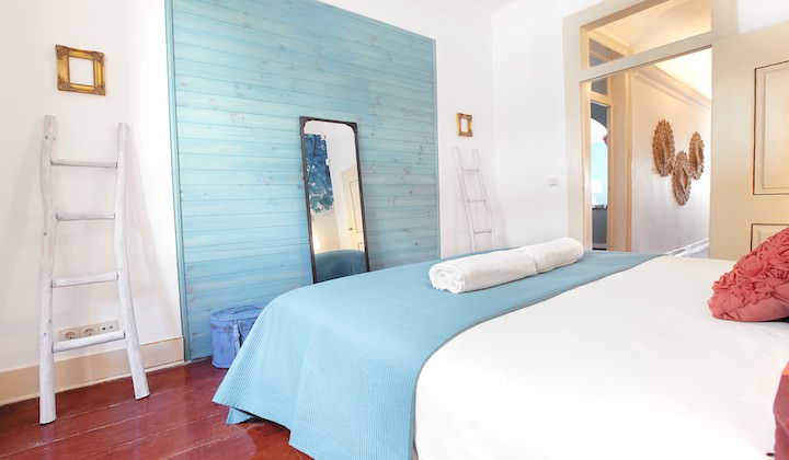 Elegantly decorated bedroom with a spacious double bed and delightful theme colour of blue.