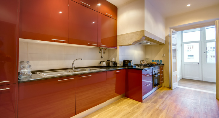 Bright and superior kitchen with red cupboards