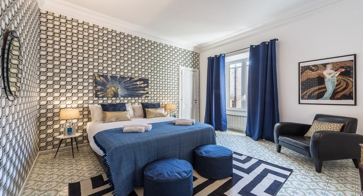 This bedroom comes with a wide king-sized bed, and a very trendy sofa on the side to enjoy with. The room has a blue color palette accent giving a cool and relaxed ambiance.