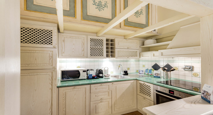 Italian kitchen with beige cabinets